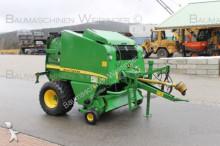 John Deere haymaking