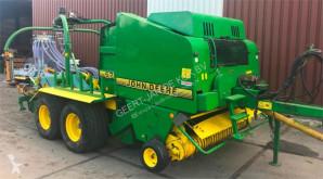 John Deere 575 haymaking