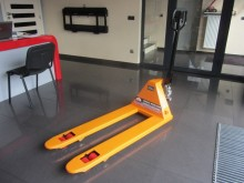 Powerlifter stand-on pallet truck