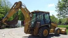 экскаватор-погрузчик с жесткой рамой Caterpillar