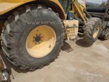 View images New Holland backhoe loader