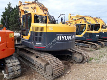 Voir les photos Tractopelle Hyundai R235 LCRD - 9 + tête d\'abattage Woody