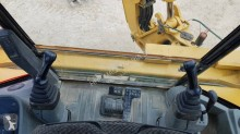 Vedeţi fotografiile Buldoexcavator Caterpillar
