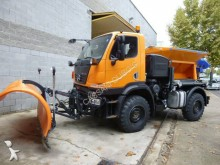 camión volquete trilateral Unimog