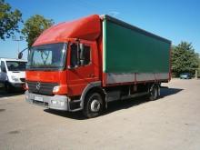 camion plateau ridelles bâché Mercedes