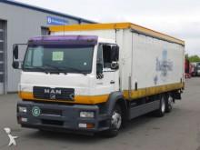 camión caja abierta transporte de bebidas MAN