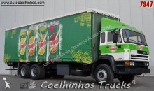 camião caixa aberta com lona usado
