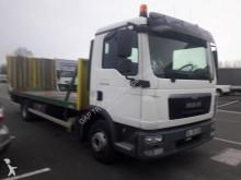 camión portamáquinas MAN