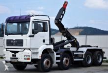MAN skip truck