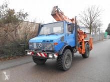 camion Mercedes Unimog 427/11 Bagger