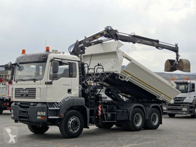 Voir les photos Camion MAN TGA 26.360/2 SIDED TIPPER+CRANE TEREX 135.2/