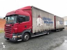 Scania Lastzug Pritsche und Plane Schiebeplanenaufbau