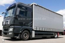 inna ciężarówka z przyczepą MAN