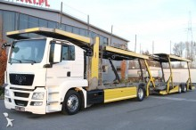 ciężarówka z przyczepą do transportu samochodów MAN