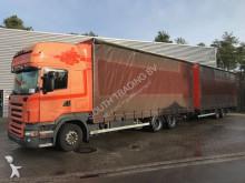 Scania Lastzug Pritsche und Plane