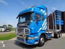 tractora semi maderero Scania
