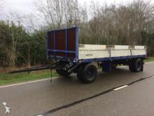 vrachtwagencombinatie platte bak onbekend