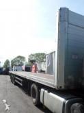 damaged flatbed semi-trailer
