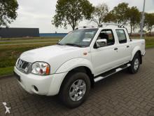 utilitaire plateau Nissan