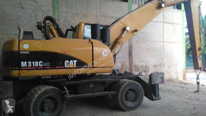alt utilaj Caterpillar Cat m318cmh