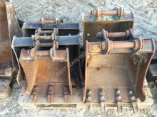 Caterpillar tiltable ditch cleaning bucket